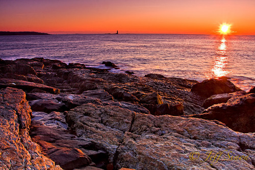 Sunrise seen from Fort Stark historic site in New Castle, NH. Whaleback Light can be seen in the distance.