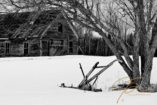 Abandoned barn and antique plow, Jefferson, NH