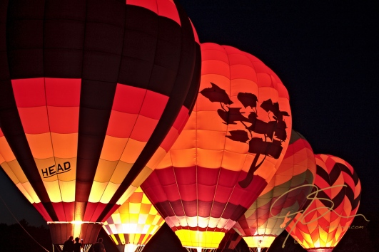 Hor air balloons glow at night