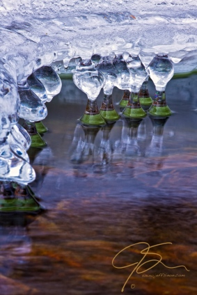 Abstract icicles on the side of a stream