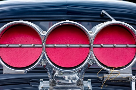 three circular throttle plates on a drag car hood scoop.