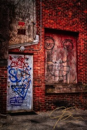Graffiti on doors in alley