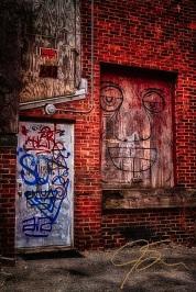 Graffiti on doors in alley