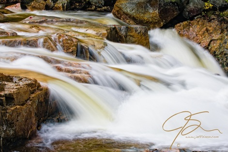 The power of the Swift River is on full display as its tannin stained water crashes into Rocky Gorge in the White Mountain National Forest, NH.