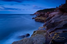 Otter Cliffs in Acadia National Park, photographed during the blue hour, that time before twilight when everything has a blue color to it. This long, 61 second exposure show the movement of the clouds and the surf along the rugged granite shore leading up to Otter Cliffs in the distance.