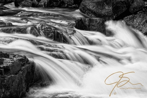 The power of the Swift River in the White Mountains of New Hampshire is on full display as it crashes into Rocky Gorge, in this black and white image.