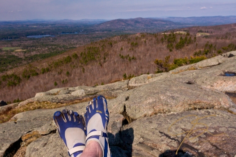 Foot shot of me wearing my Five fingers sitting atop Bald Knob overlooking Castle In The Clouds.