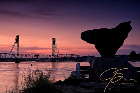 The statue on Four Tree Island overlooks the Memorial Bridge between Portsmouth, NH and Kittery, ME.