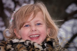 My beautiful blue eyed daughter Nicole in her leopard print winter coat. Sitting in a tree smiling down at me.
