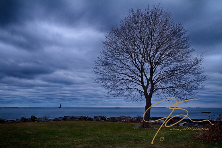 Storm clouds over Whaleback Light. Great Island Commons, New Castle, NH.