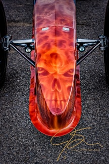 The artistically applied air brush art on the nose of a dragster.