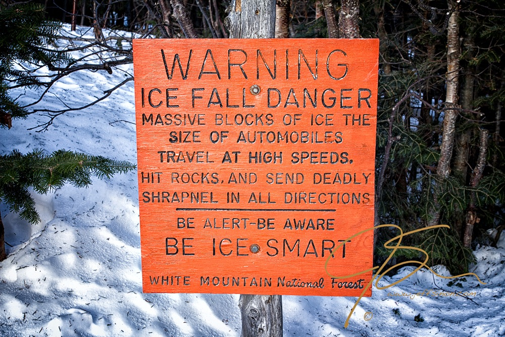 Bright orange ice fall warning sign in Tuckerman Ravine