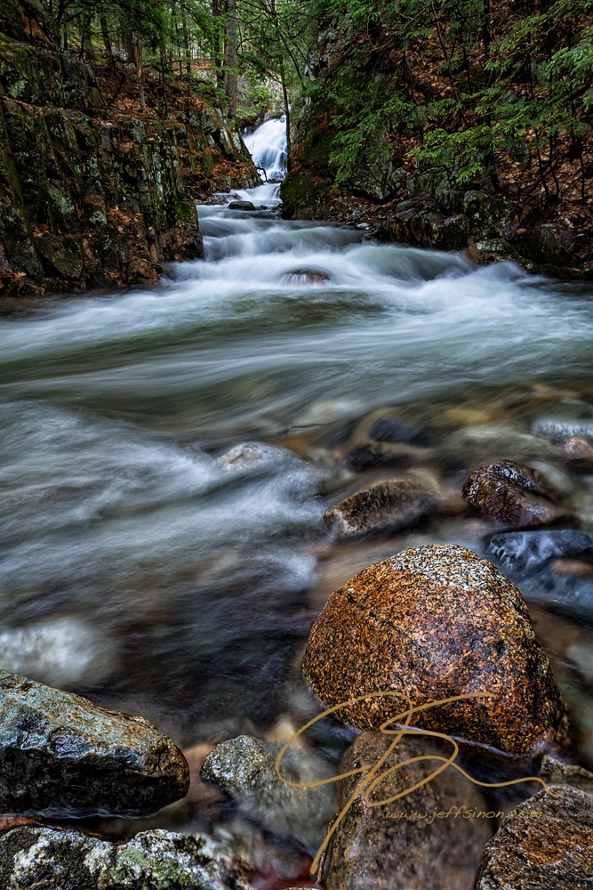 Vertical image looking upstream towards Bridal Veil falls, Castle in the Clouds, Moultonborough, NH