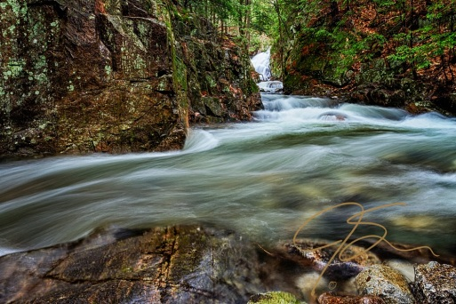 Horizontal image looking upstream towards Bridal Veil falls at Castle in the Clouds, Moultonborough, NH