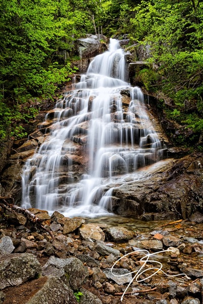 Beautiful vertical image of Cloudland Falls on the Falling Waters Trail. Long exposure giving the cascading water a silky smooth look as it crashes over the 50 foot falls.