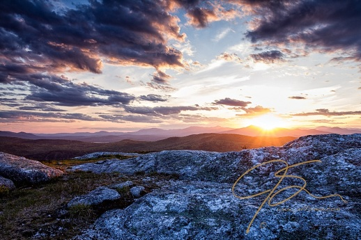As the sun is about to set over the distant mountains, it cast its last rays over the summit of Foss Mountain.