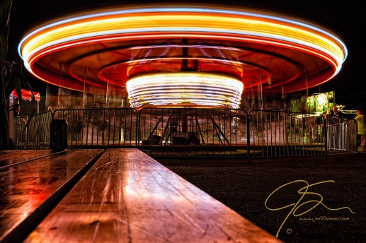 Long exposure night time shot of a carousel