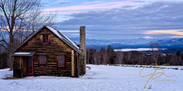 Spectacular scenic view from a rustic log cabin.