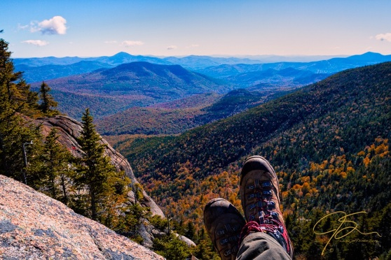 Sitting high atop Stairs Mountain overlooking the vast White Mountains of New Hampshire.