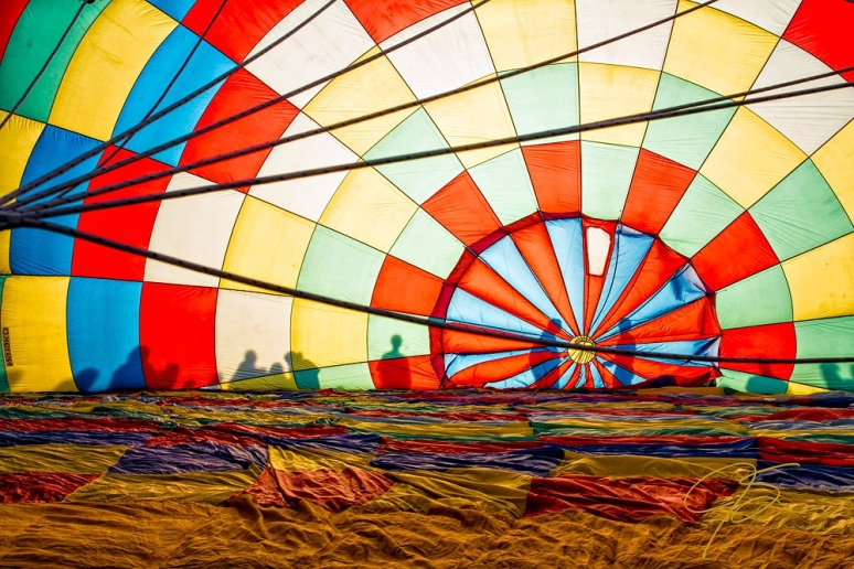 Silhouettes, Shadows On A Partially Inflated Hot Air Balloon.
