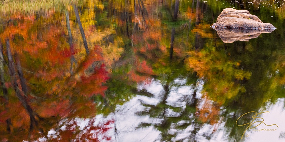 Colorful fall color reflected on the water