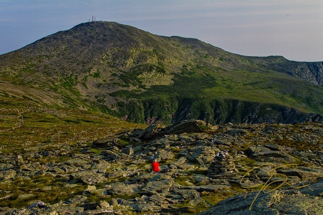 A lone hiker rests on his way to the summit of Mount Washington