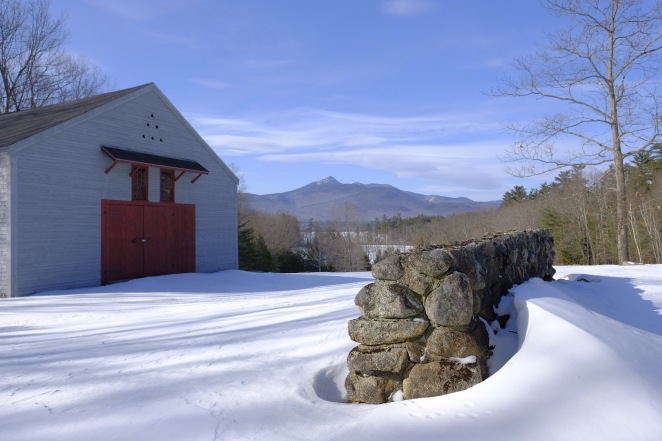 Gray barn with red door, overlooking mount Chocorua, New Hampshire winter scenery