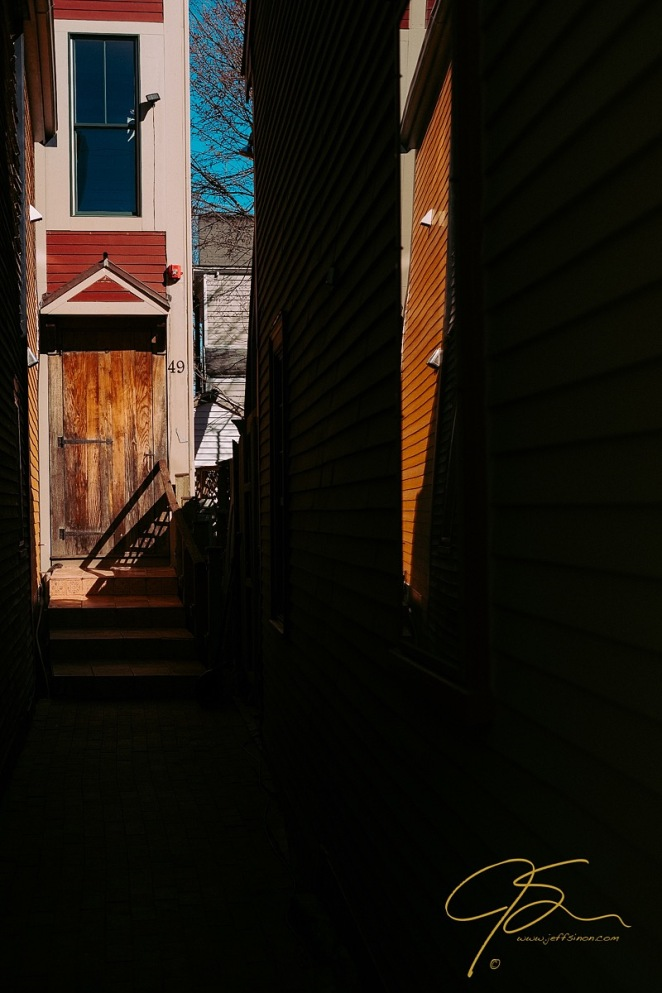 Sunlit doorway in at the end of an alley in Portsmouth, New Hampshire.