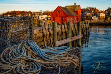 motif #1 with lobster traps and blue rope in the foreground