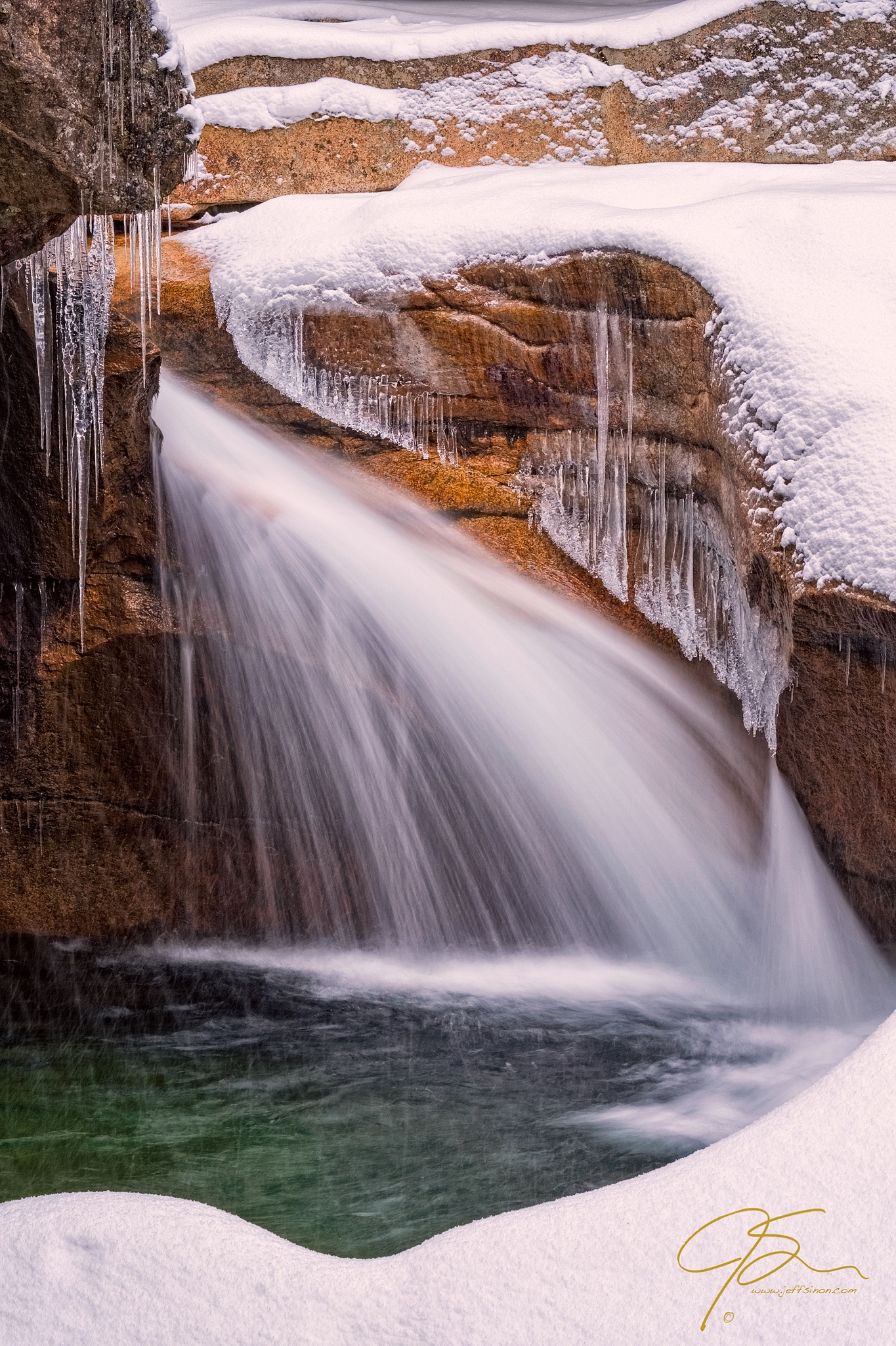 Snowy closeup of The Basin, a scenic waterfall in Franconia Notch, NH.