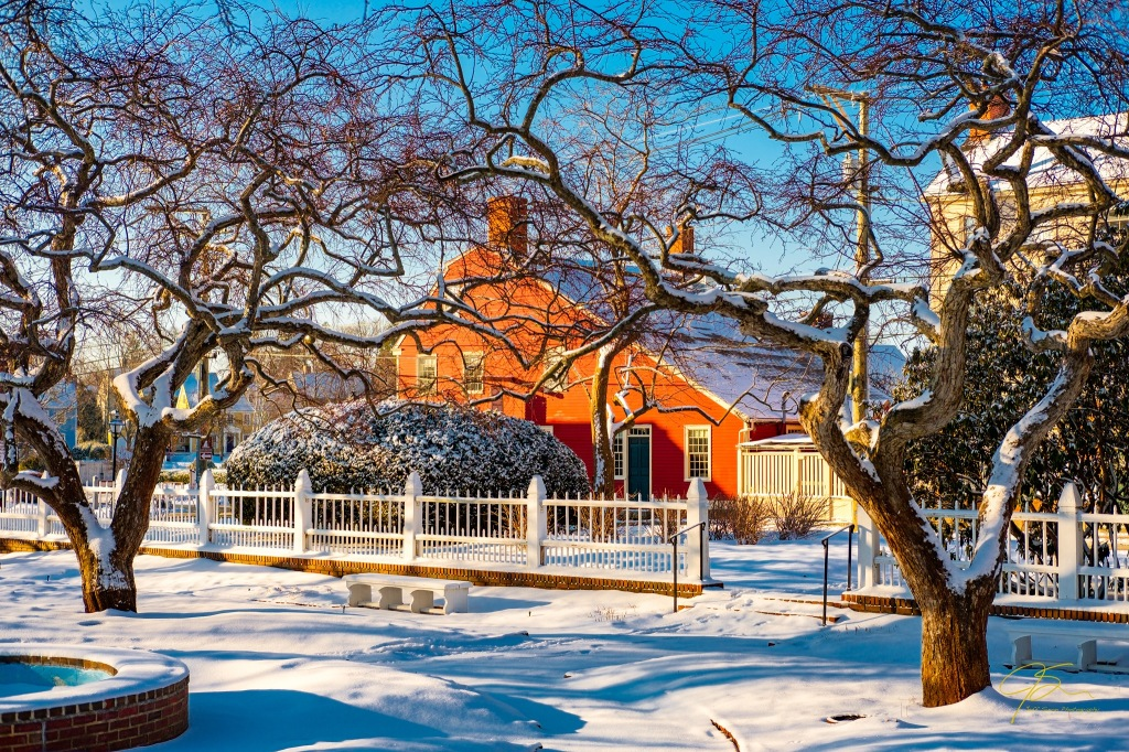 red house and snow covered cherry trees, prescott park gardens