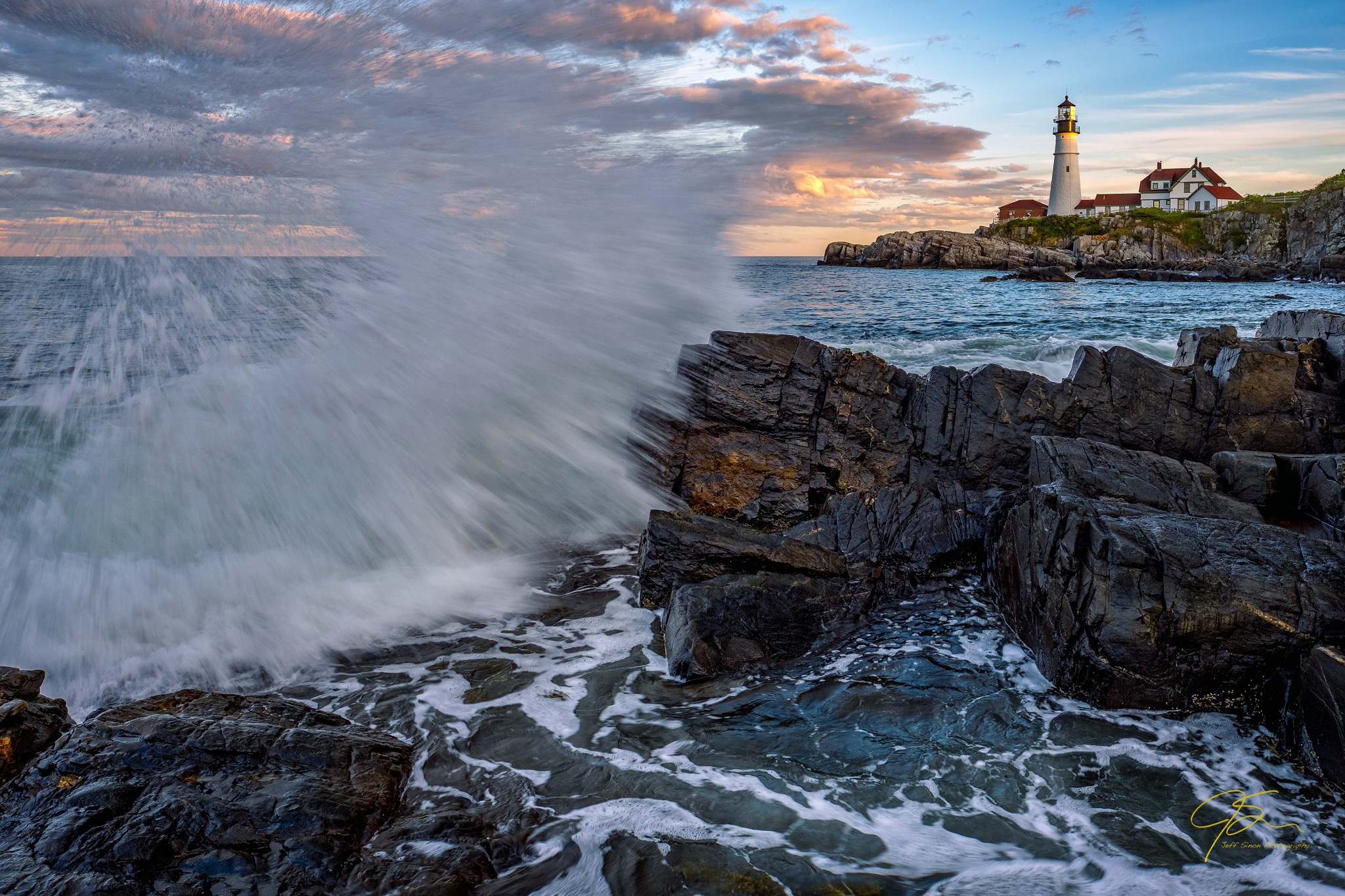 sunset and big crashing waves with Portland head light in the background