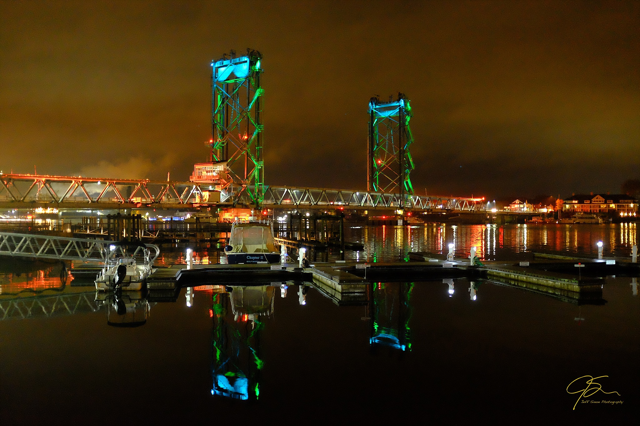 memorial bridge at night with the bridge towers lit in blue light.