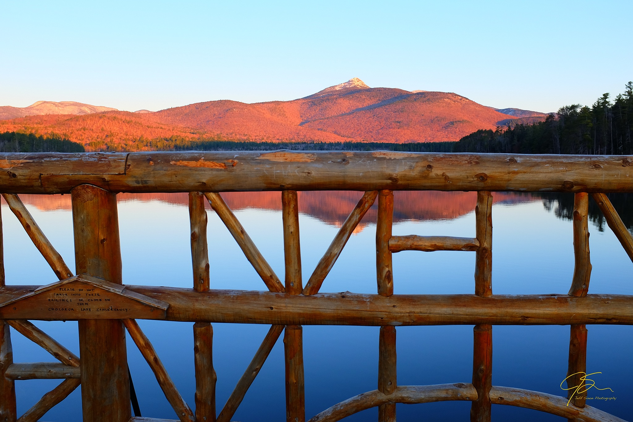 mount Chocorua as seen looking over the hand-made raisins of the bridge on chocorua lake road
