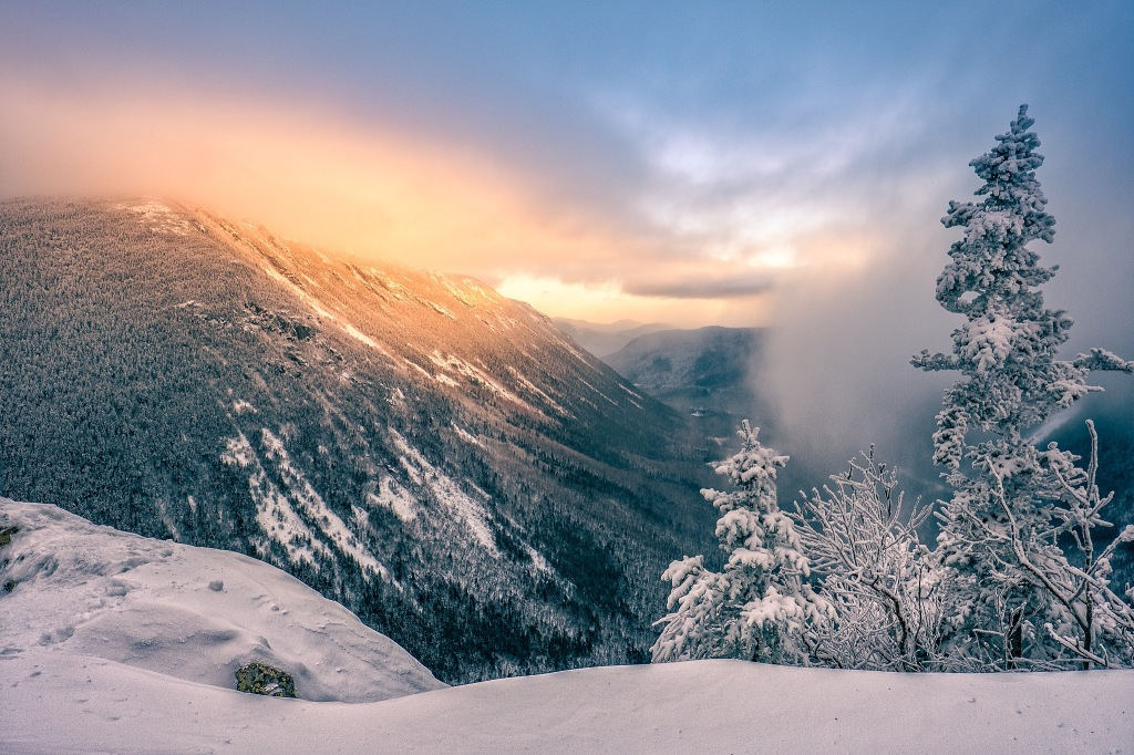 momentary glow over wintery Crawford Notch New Hampshire